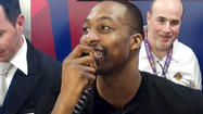 Dwight Howard made a surprise visit to LAX on Thursday, working the check-in counter at Delta Air Lines and taking boarding passes at a gate.