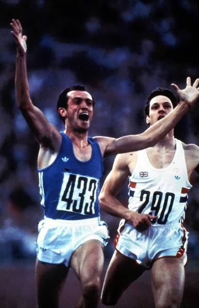 Italian sprinter Pietro Mennea, left, exults after winning the gold medal in the 200 meters at the Moscow Summer Olympics in 1980. Mennea, who held the word record in the event for 17 years, has died at the age of 60.
