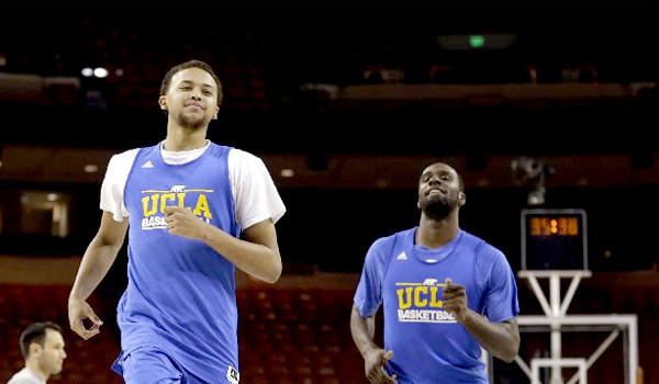 UCLA's Kyle Anderson runs with Shabazz Muhammad during practice for a second-round game of the NCAA college basketball tournament against the Minnesota Golden Gophers.