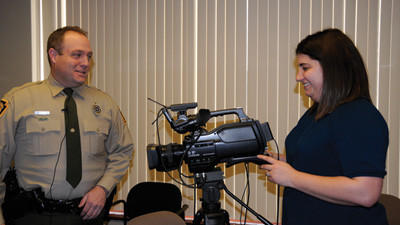 "Wildlife Conservation Officer Brian Witherite and Daily American Assistant City Editor Michelle Ganassi prepare for the live broadcast of ""DA Live."" See the video at dailyamerican.com"