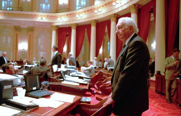 Nicholas Petris on the floor of the state Senate in 1996. In the Legislature he wrote laws barring smoking on planes, trains and buses in the state and introduced a bill calling for the elimination of the internal combustion engine.
