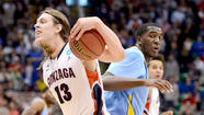 SALT LAKE CITY — What a sight it was seeing Gonzaga star center Kelly Olynyk consoling a distraught opponent who fell just short of pulling off one of the great upsets in NCAA tournament history.