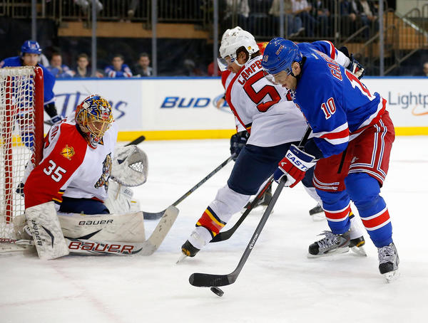 NEW YORK, NY - MARCH 21: Goalie Jacob Markstrom #35 of the Florida Panthers protects his goal as Marian Gaborik #10 of the New York Rangers controls the puck during the second period of an NHL hockey game at Madison Square Garden on March 21, 2013 in New York City. Panthers won 3-1.(Photo by Paul Bereswill/Getty Images) ORG XMIT: 162764121