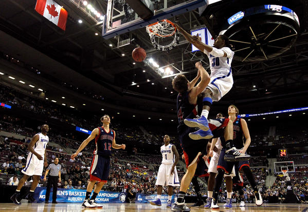 D.J. Stephens #30 of the Memphis Tigers dunks on Matthew Dellavedova #4 of the St. Mary's Gaels in the second half during the second round of the 2013 NCAA Men's Basketball Tournament at at The Palace of Auburn Hills on March 21, 2013 in Auburn Hills, Michigan.