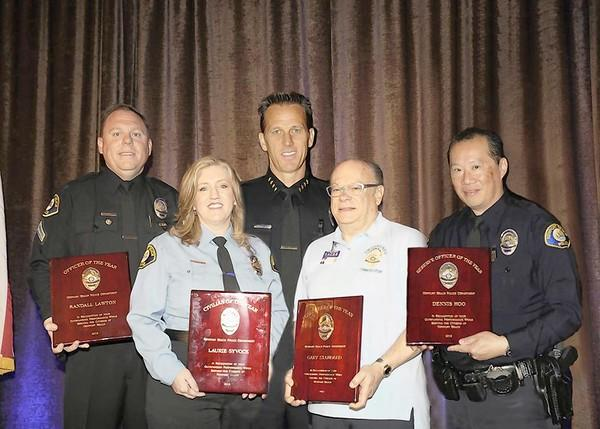 Left to right: Officer Randall Lawton, Senior Dispatcher Laurie Syvock, Chief Jay Johnson, R.A.C.E.S. Volunteer Gary Standard and Reserve Officer Dennis Hoo.
