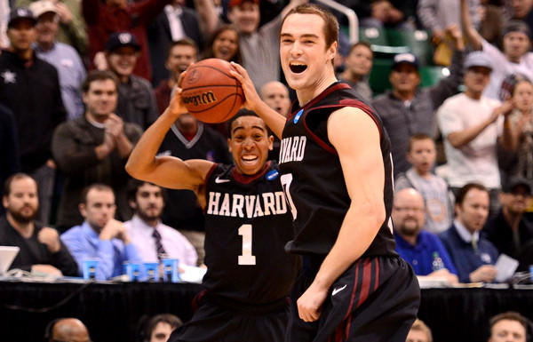 Harvard guard Siyani Chambers (1) and forward Laurent Rivard begin to celebrate after defeating New Mexico, 68-62, on Thursday.