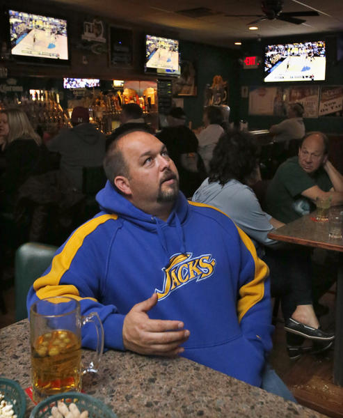 South Dakota State University fan Brian Bjordal, of Aberdeen, was among the basketball fans watching the Jackrabbits play their second round game at the NCAA Tournament on television at Lager's Inn Thursday evening. photo by john davis taken 3/21/2013