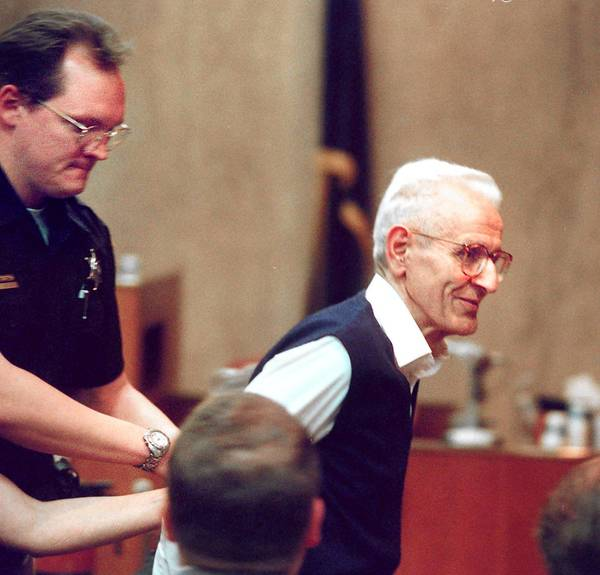 The late Dr. Jack Kevorkian, shown being handcuffed in 1999, went to prison for ending the agony of terminally ill patients. Pennsylvania legislation to allow 'death with dignity' has stalled.