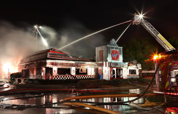 Orange County Firefighters are still trying to quench flames at the 5 & Diner, a 1950s-themed eatery, after receiving reports of smoke about 2:45 a.m. in the 12000 block of East Colonial Drive near Waterford Lakes Town Center..Fire Rescue dispatched several units to extinguish the raging blaze that caused the roof to collapse.