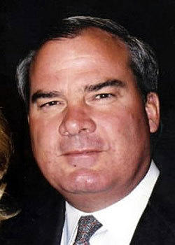 A photograph was taken of former Gov. John Rowland at an event in 2011. He is the center of an ongoing grand jury probe.