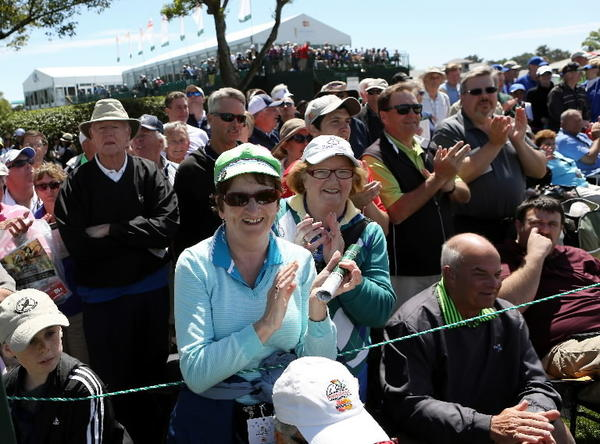 Siobhan Duffy, bottom left blue shirt and green hat, and Anne Shanahan, right, from Ireland applaud tiger Woods, Ernie Els and Justin Rose on the 9th hole on Thursday afternoon, March 21, 2013 during the Arnold Palmer Invitational. Jacob Langston/Orlando Sentinel)