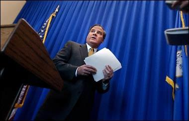 Gov. John G. Rowland exits a press conference in 2003, without taking questions from reporters, after making a statement responding to the lawsuit filed against him and his budget chief, Marc S. Ryan.