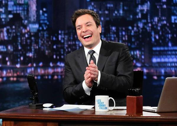 "This Feb. 21, 2013 photo released by NBC shows Jimmy Fallon, host of ""Late Night with Jimmy Fallon,"" on the set in New York. As Jay Leno lobs potshots at ratings-challenged NBC in his ""Tonight Show"" monologues, speculation is swirling the network is taking steps to replace the host with Jimmy Fallon next year and move the show from Burbank to New York. NBC confirmed Wednesday, March 20, it's creating a new studio for Fallon in New York, where he hosts ""Late Night."" But the network did not comment on a report that the digs at its Rockefeller Plaza headquarters may become home to a transplanted, Fallon-hosted ""Tonight Show."" (AP Photo/NBC, Lloyd Bishop) ** Usable by LA and DC Only **"