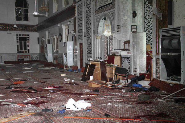 The damaged Iman Mosque after the suicide bombing Thursday that killed Muhammad Bouti, an 84-year-old cleric allied with the Syrian government. The photo was released by the Syrian official news agency SANA.