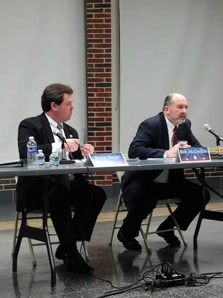 Geneva Mayor Kevin Burns, left, and his challenger Bob McQuillan face off during a candidate forum.