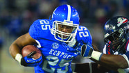 LEXINGTON — Running back Jonathan George believes he has the versatility and experience that will enable him to fit into Kentucky offensive coordinator Neal Brown's system.