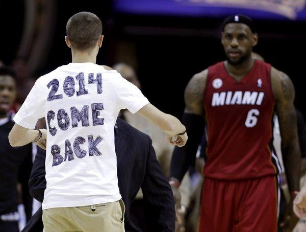 A fan runs onto the court during Wednesday's Heat-Cavs game to meet LeBron James and maybe get a message across.
