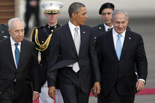 Israeli President Shimon Peres, left, President Obama and Israeli Prime Minister Benjamin Netanyahu walk together prior to Obama's departure from Ben Gurion International Airport on Friday.
