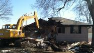 PHOTOS: Homes damaged in jet crash torn down
