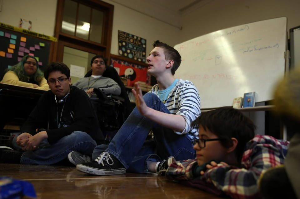 Lane Tech High School book club's Levi Todd, 16, talks during club meeting after class in Chicago.
