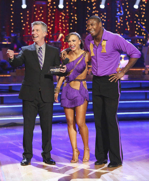 "Jacoby Jones stands with pro partner Karina Smirnoff and host Tom Bergeron during Week 1 on ""Dancing With the Stars."""