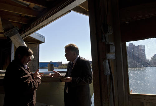 Gubernatorial candidate Terry McAuliffe (right) speaks with owner Meade Amory during a tour of L.D. Amory & Co. in Hampton on Friday.