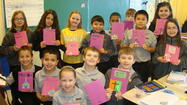Third graders in Mrs. Carole Yesensky's class at St. Pius X Parish School are very excited about the Holy Week booklets they designed during religion class. The booklets are a yearly project in Mrs. Yesensky's class.
