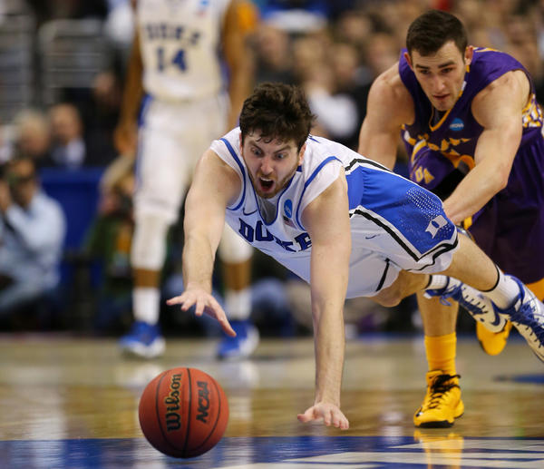 Ryan Kelly of the Duke Blue Devils dives for a loose ball in the second half.