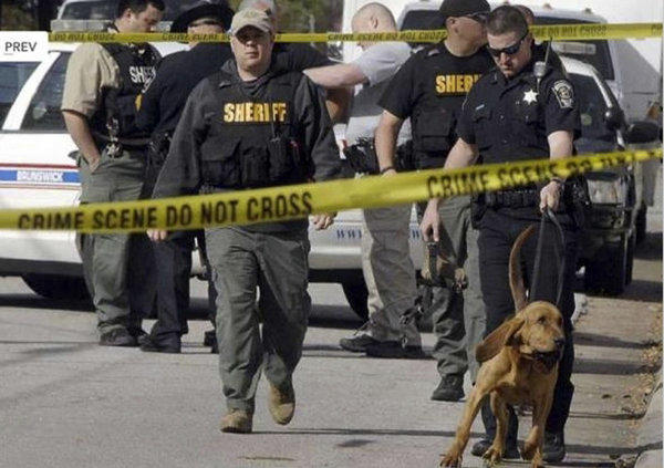 Authorities investigate the scene of the shooting in Brunswick, Ga.