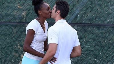 Spotted: Venus Williams puckers up to her Cuban hottie