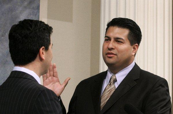Felipe J. Fuentes III, right, is sworn in to the California Assembly in 2007. Now, while waiting to take an L.A. City Council seat to which he was elected, he is still on the Assembly payroll as a staff member to his successor.