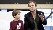 "Actors Zachary Unger (""Young Will""), left, and Norbert Leo Butz (""Edward"") rehearse a scene of the musical ""Big Fish."""