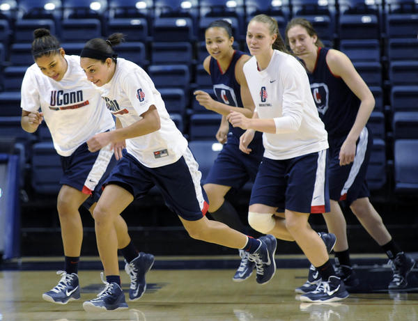 STORRS 03/22/13 The Connecticut Huskies Kaleena Mosqueda-Lewis and Bria Hartley lead off a jog around the floor at the start of practice at Gampel Pavilion on the eve of the first round of the NCAA tournament.