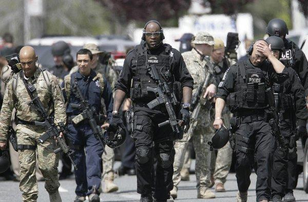 A SWAT team from the Oakland Police Department leaves the scene of an April 2012 shooting at Oikos University in Oakland.