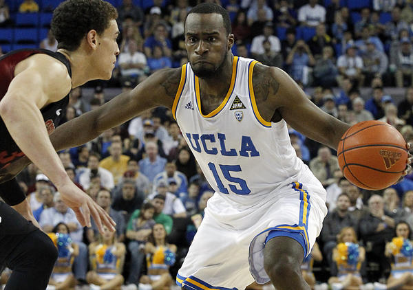 UCLA guard Shabazz Muhammad looks for a lane to the basket against the defense of Stanford forward Dwight Powell at Pauley Pavilion.