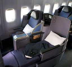 "United Airlines' lay-flat seats are featured in its new ""premium service."""