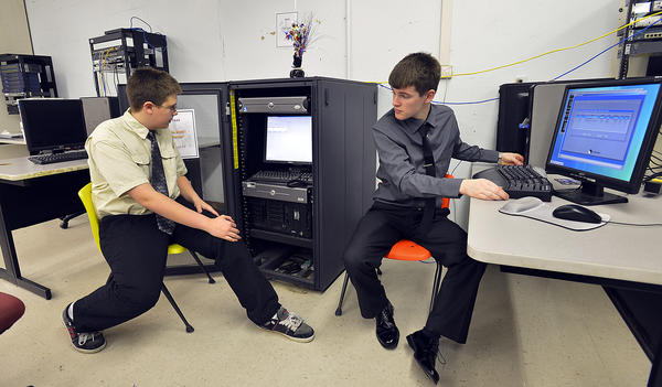 Washington County Technical High School students Jason Shaffer, left, and Jeremy Frocke describe a computer program that can be used to restore computers to a safe state once they have been hacked. The school held a cyber security awareness day Friday.