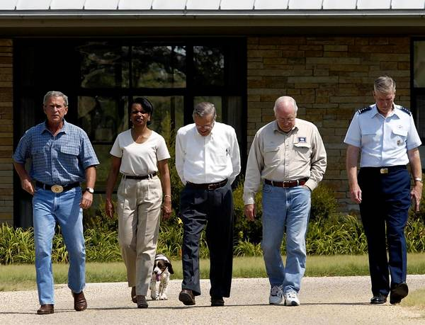 President George W. Bush, far left, takes a walk at his Crawford, Texas ranch with his key advisers on Iraq in 2003: Condoleezza Rice, Donald Rumsfeld, Dick Cheney and Air Force Gen. Richard Myers.