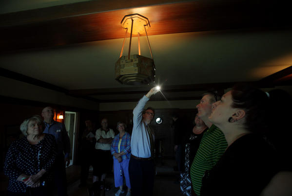 "Docent Michael Murray, middle, leads a ""Behind the Velvet Ropes"" tour at the Gamble House in Pasadena."
