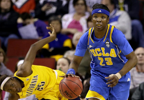 UCLA's Markel Walker (23) heads upcourt as California's Gennifer Brandon regains her footing.