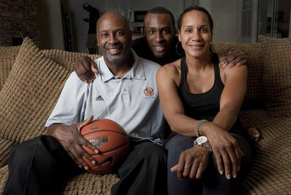 UCLA player Shabazz Muhammad is photographed with his parents, Ron and Faye, in 2011.