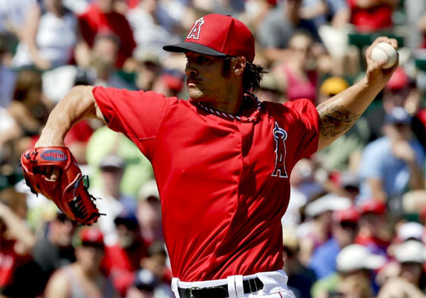Angels starting pitcher C.J. Wilson throws against the San Diego Padres.