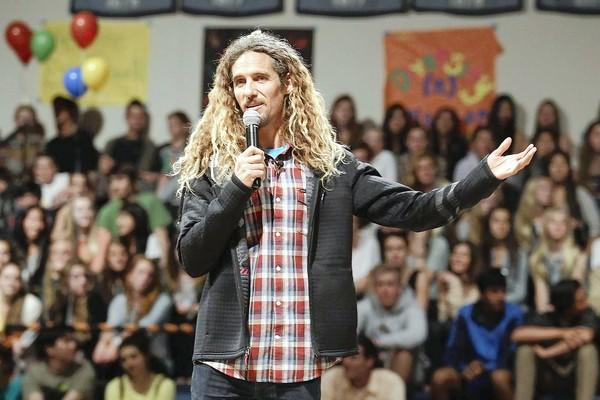 Professional surfer Rob Machado speaks to students during a World Water Day event at Corona del Mar High School on Friday.