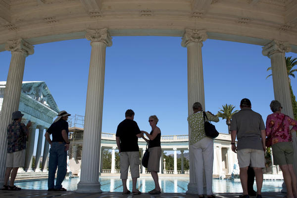 Tourists visit the famous Neptune Pool at Hearst Castle. A new report says the former hilltop home of William Randolph Hearst is one of dozens of sites the state parks department may no longer be able to manage.