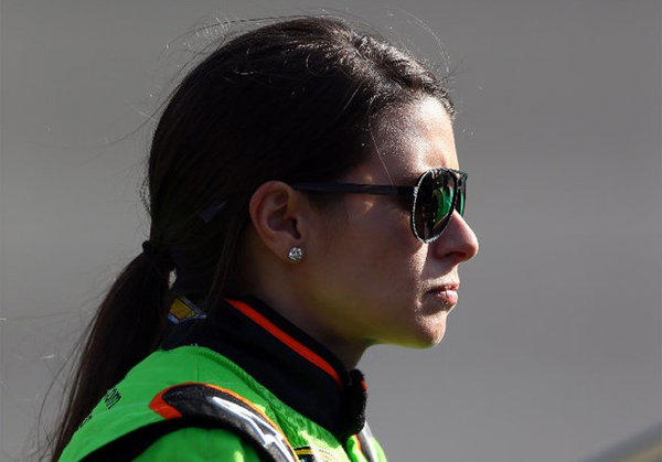 Danica Patrick stands on the grid during qualifying at Auto Club Speedway in Fontana.
