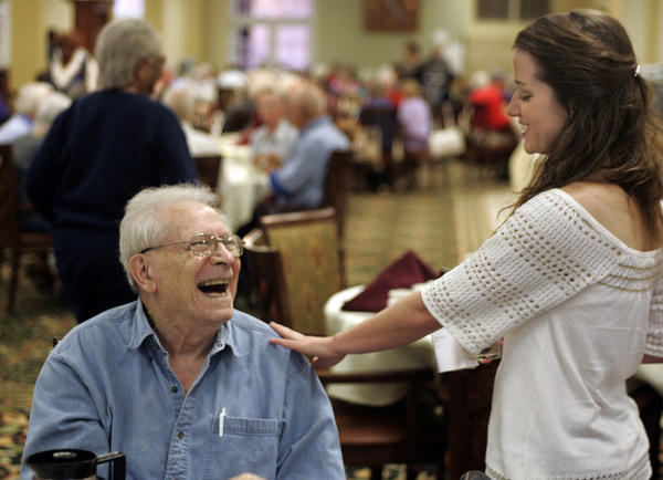 Julie Thomas shares a laugh with Jerry Donson, a resident at Kingsley Manor Senior Center in October 2007. In neighborhoods around L.A., civic groups have opposed elder care facilities.