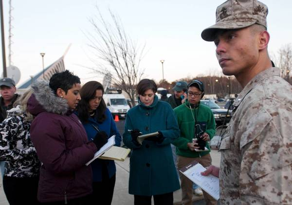 "Marine 1st Lt. Agustin Solivan answers reporters' questions about the Quantico murder-suicide. Base commander Col. David Maxwell said: ""This is a tragic loss for our Marine Corps family."""