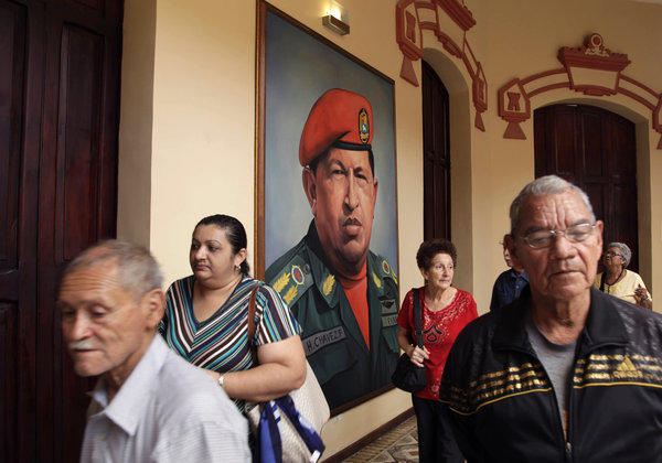 A painting of Venezuela's late President Hugo Chavez in a military uniform hangs near his tomb at the Military Museum in Caracas, Venezuela.