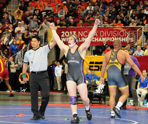 Easton native and Northwestern wrestler Mike McMullan celebrates after winning his semifinal bout in overtime against Missouri's Dom Bradley during the NCAA Division I Wrestling Championships held at the Wells Fargo Arena in Des Moines, Iowa. McMullan will wrestle in the finals on Saturday night.