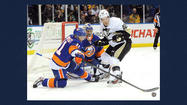UNIONDALE, N.Y. (AP) — Tomas Vokoun was sharp in making 33 saves, and Brandon Sutter snapped a tie early in the third period for the Pittsburgh Penguins, who rallied for a 4-2 victory over the New York Islanders that stretched their winning streak to 11 games on Friday night.